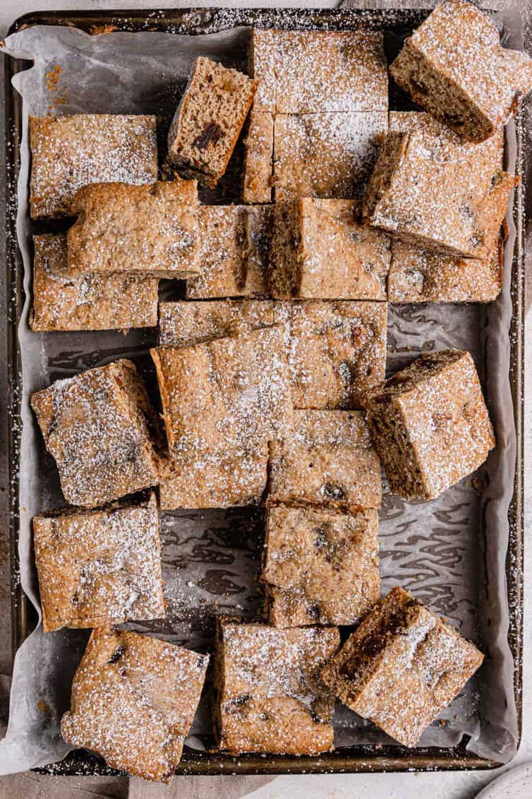 Date bars cut into squares on baking pan.