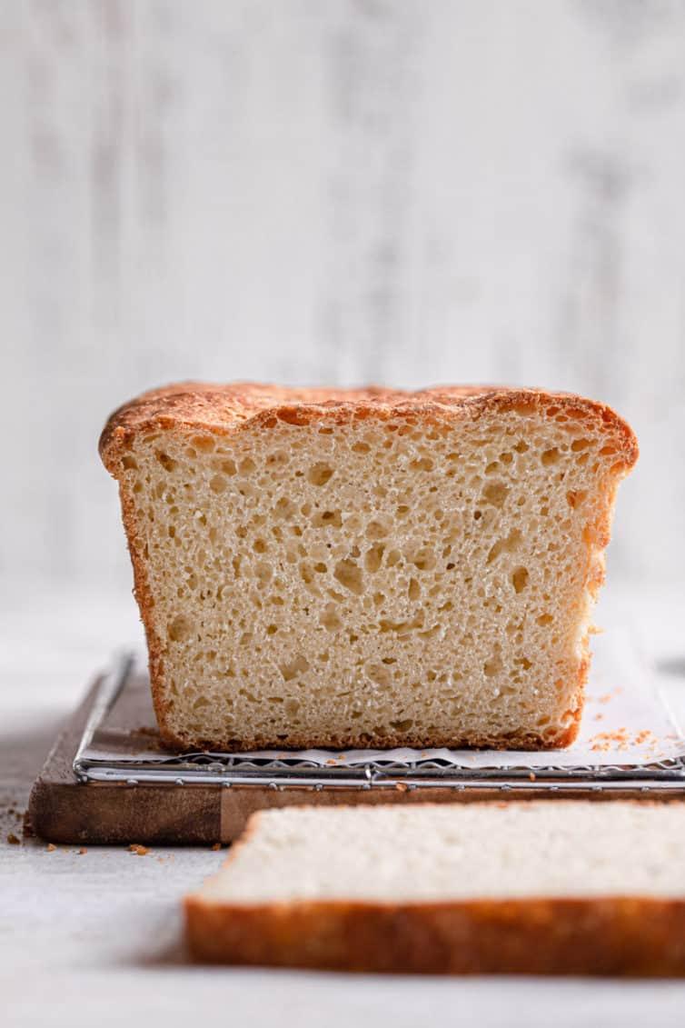 Sliced english muffin bread on a cutting board.