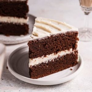 A slice of chocolate Guinness cake on a white plate.