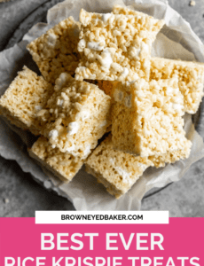 A silver plate lined with parchment paper with a stack of rice krispie treats on top and a pink rectangle at the bottom with the words Best Ever Rice Krispie Treats at the bottom in white.