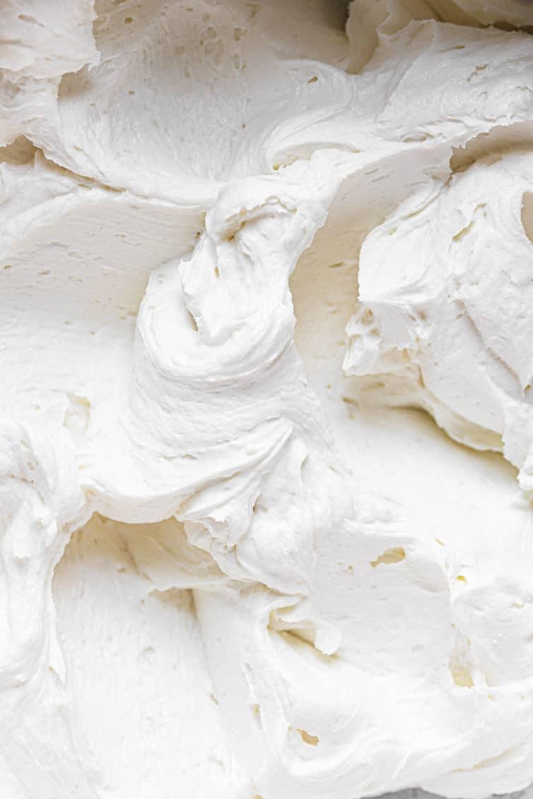 Swirls of vanilla buttercream frosting.