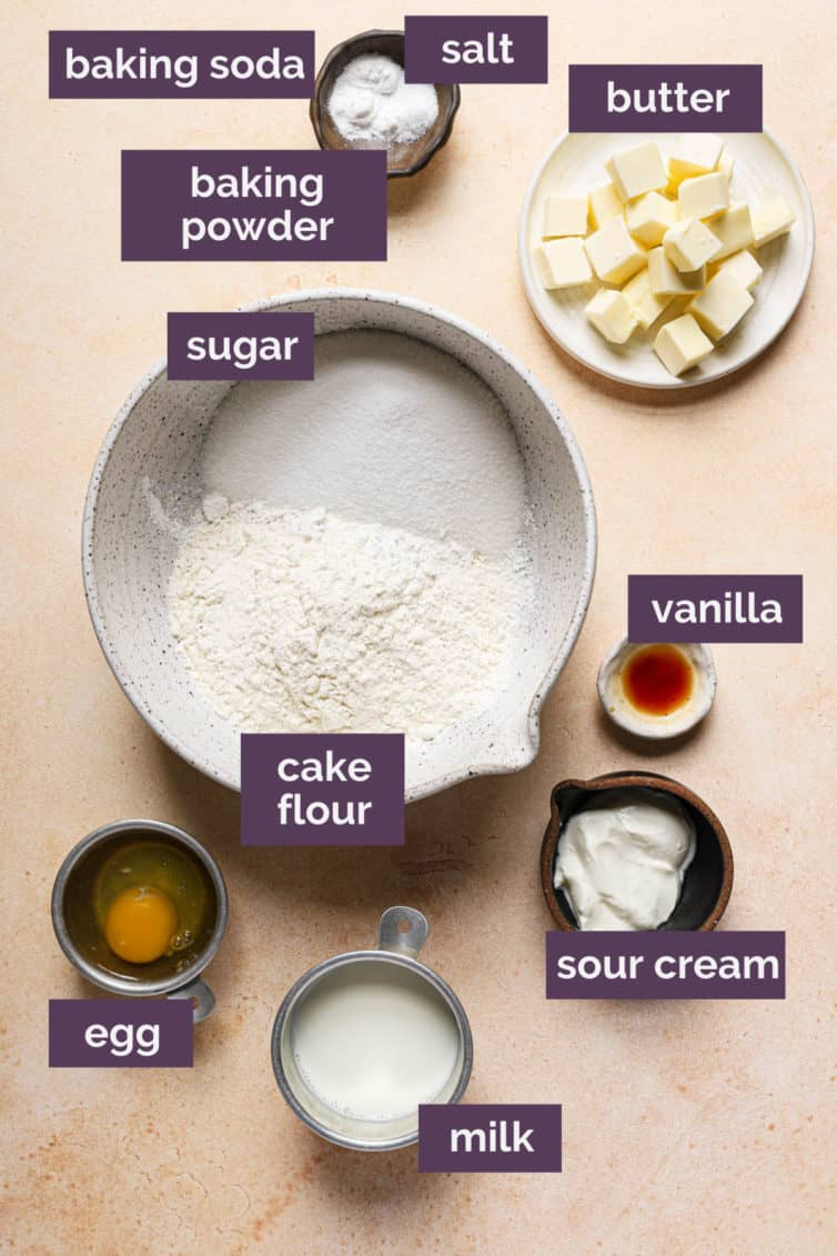 Ingredients for vanilla cupcakes on a counter labeled with purple labels.