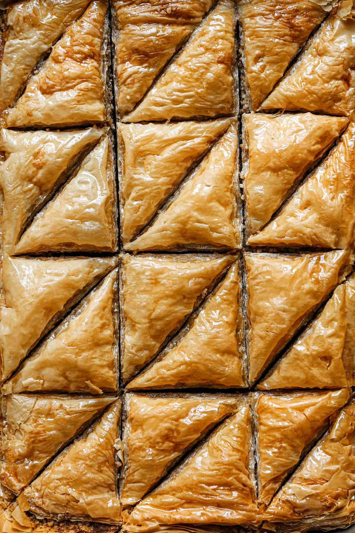 Top down photo of baklava cut into triangles.