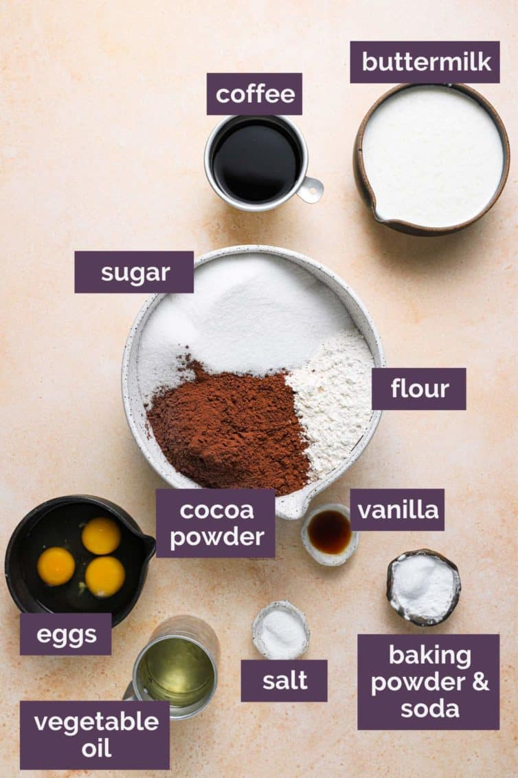 A top down photo of the ingredients for chocolate cake with purple labels.