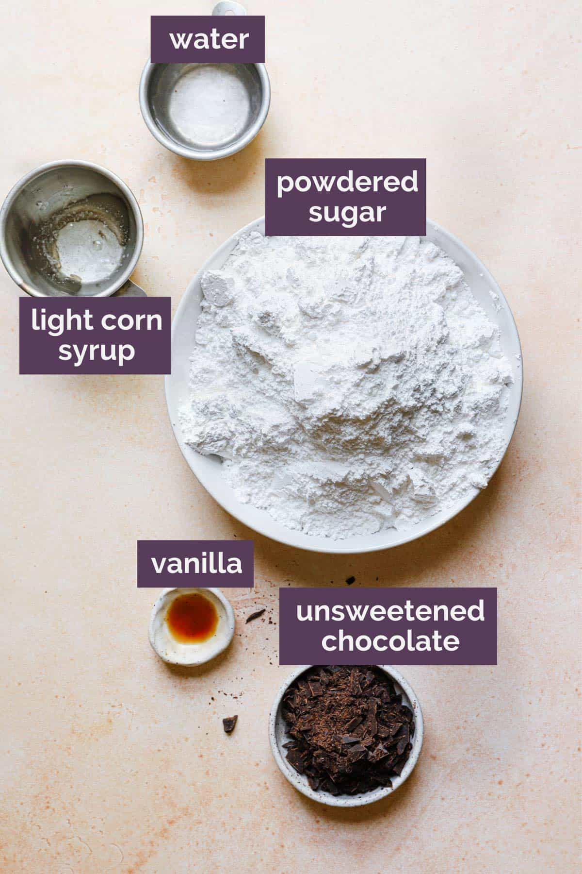 Ingredients for black and white cookie icing with purple labels saying what each ingredient is.