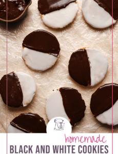 A parchment paper covered counter with black and white cookies with a pink border and the words homemade black and white cookies at the bottom.