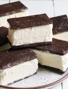 A close up shot of ice cream sandwiches on a plate.