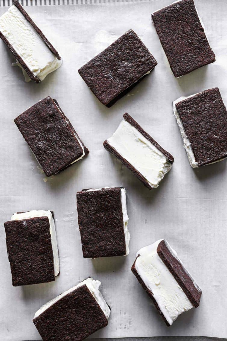 Homemade ice cream sandwiches on parchment paper.