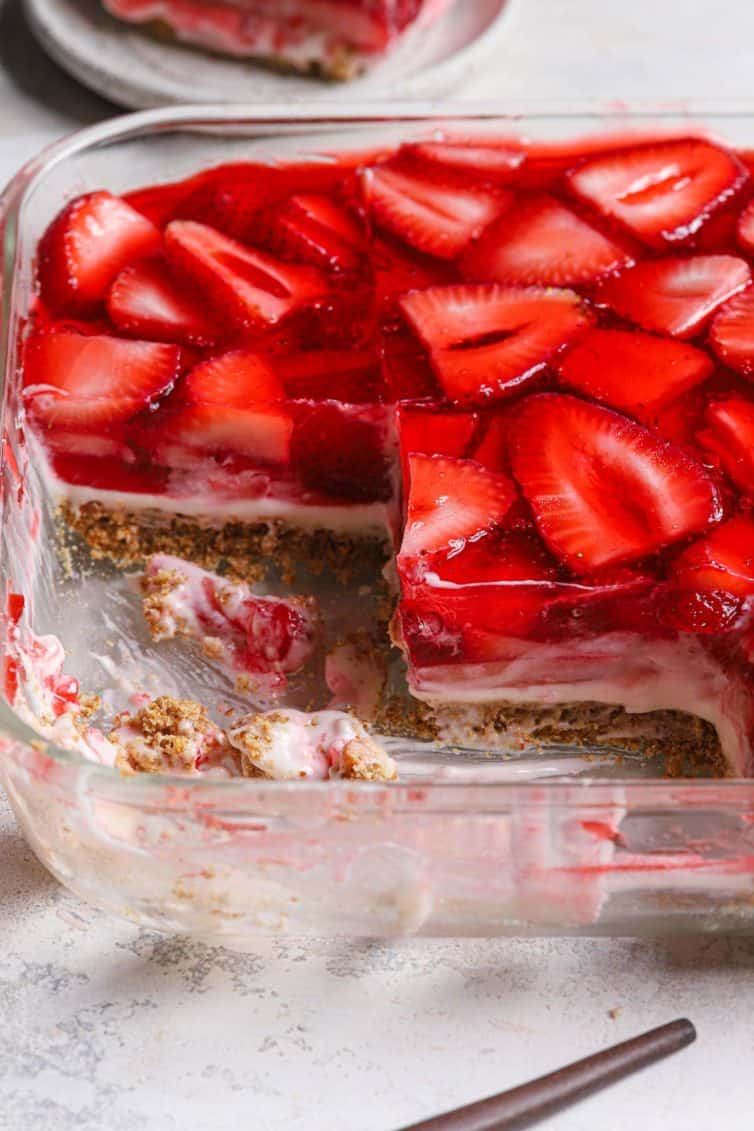 From the side photo of strawberry pretzel salad with squares cut out to show the different layers.
