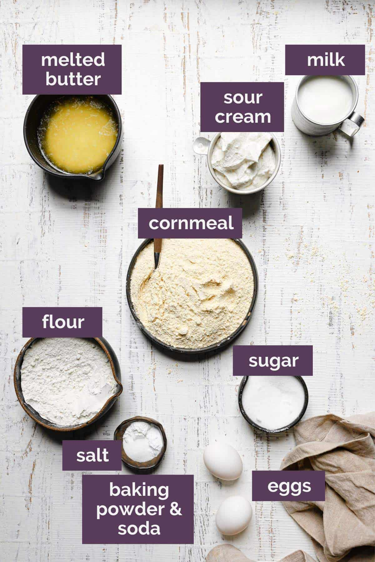 A top down photo of the ingredients for cornbread muffins labeled with purple tags.